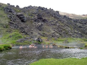 People Bathing in Natural Geothermal Pool Landmannalaugar